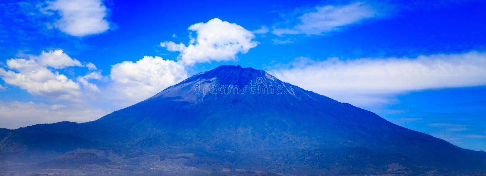 Mount Meru in Tanzania. Mount Meru is an active stratovolcano located 70 kilometres (43 mi) west of Mount Kilimanjaro in the nation of Tanzania stock image