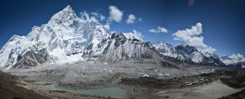 Mount Nuptse above a lake stock photography
