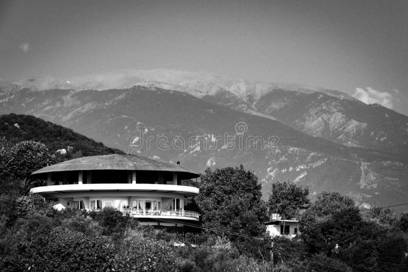 Mount Olympus in Greece behind the old circular hotel. stock image