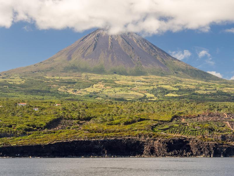 Mount Pico, Pico Island, Azores. Mount Pico with vineyards and farmland in the foreground, Pico Island, Azores stock photo