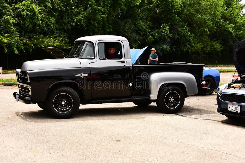1957 Dodge 100 Pickup Truck. Mount Pleasant, Wisconsin / USA - July 21, 2019.  A beautiful 1957 Dodge 100 Pickup Truck in black and silver royalty free stock images