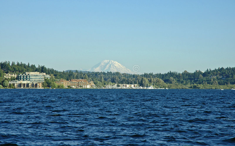 Mount Rainier and Carillon Point. From Lake Washington in Kirkland, WA stock photo