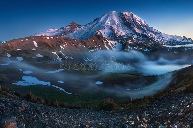 Mount Rainier in the dusk at Mount Rainier National Park, Washington State, USA. Beautiful landscape background concept royalty free stock photography