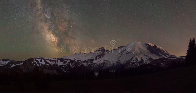 Mount Rainier Panorama under the Milky Way Galaxy. Beautiful starry sky and milky way galaxy behind Mount Rainier in Washington State stock photos