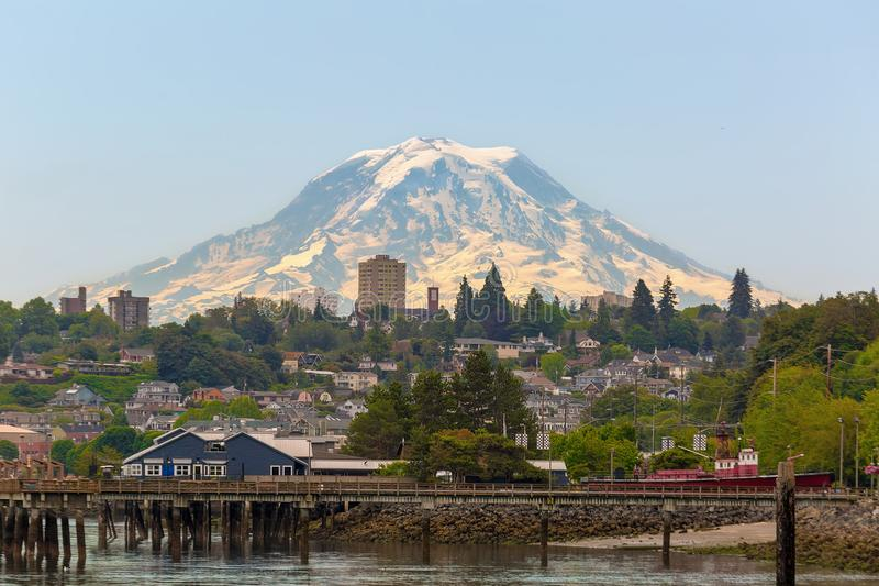 Mount Rainier at Tacoma Waterfront in Washington state. Mount Rainier over the city of Tacoma Washington waterfront on a clear blue sky sunny day stock image