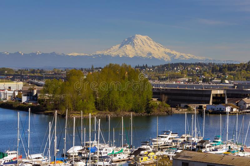 Mount Rainier from Thea Foss Waterway in Tacoma. Mount Rainier over Foss Thea Waterway in Tacoma Washington on a blue sky sunny day royalty free stock photos