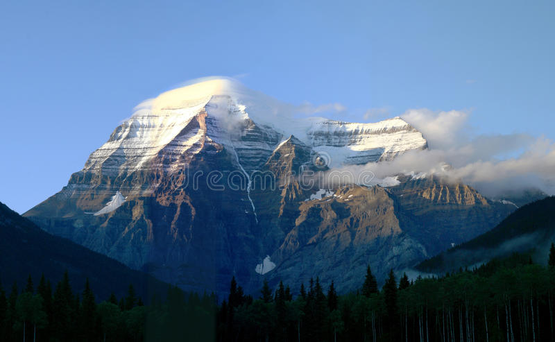Mount Robson the Highest Peak in the Canadian Rocky Mountains. Mount Robson as the Sun Sets, the Highest Peak in the Canadian Rocky Mountains royalty free stock image