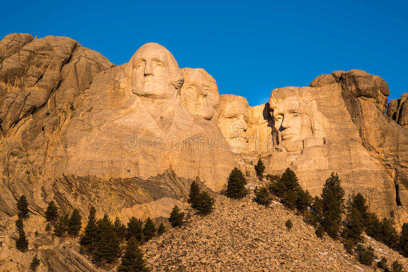 Mount Rushmore faces of the presidents at sunrise in Black Hills of South Dakota stock images