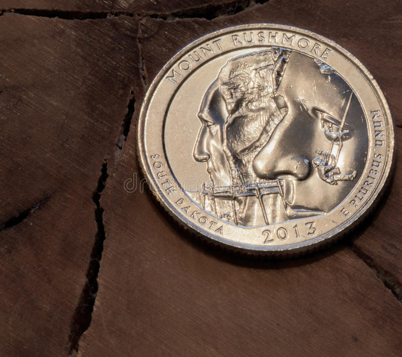 Mount Rushmore Quarter-Dollar Coin. Mount Rushmore National Memorial Quarter honoring the site located in South Dakota. This was the final quarter-dollar from royalty free stock image