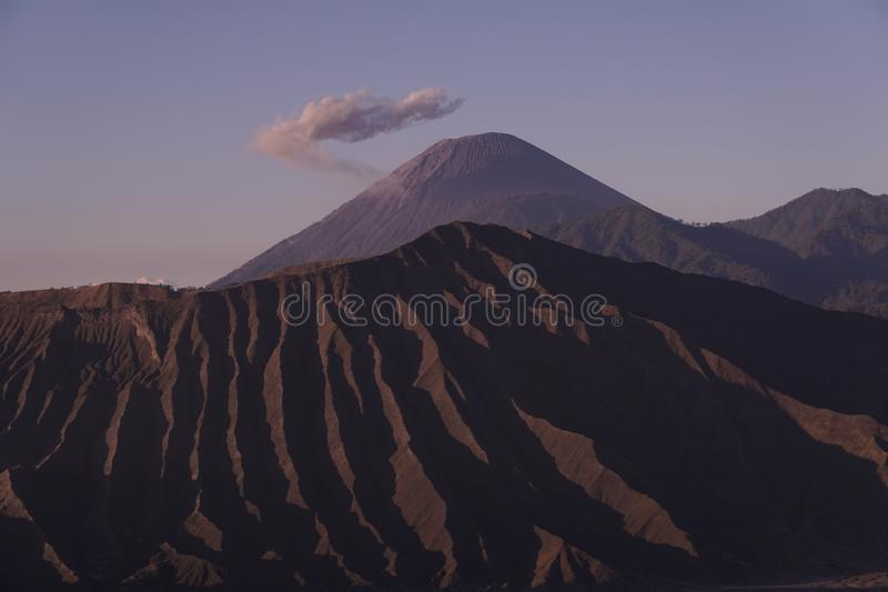 Mount Semeru with a beautiful cloud crown and foreground Bromo National Park area royalty free stock image