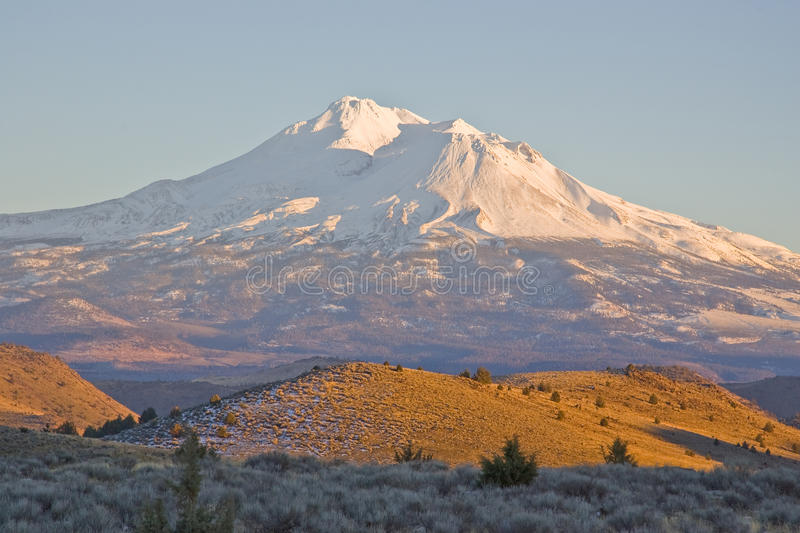 Mount Shasta California. Scenic view of Mount Shasta just before sundown, the second largest volcano in the United States royalty free stock photos