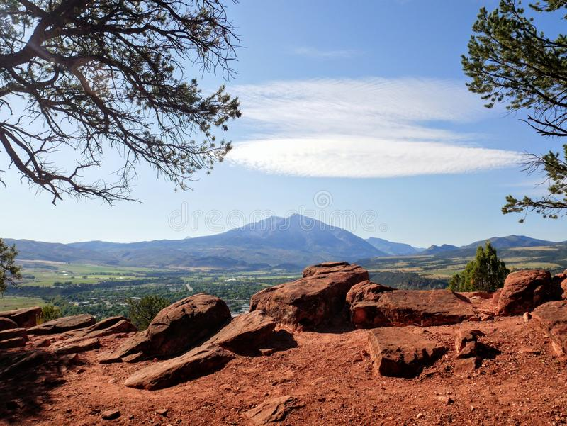 Mount Sopris from mushroom rock trail. Red, mountain, colorado, carbondale, tree, cloud, sky stock images