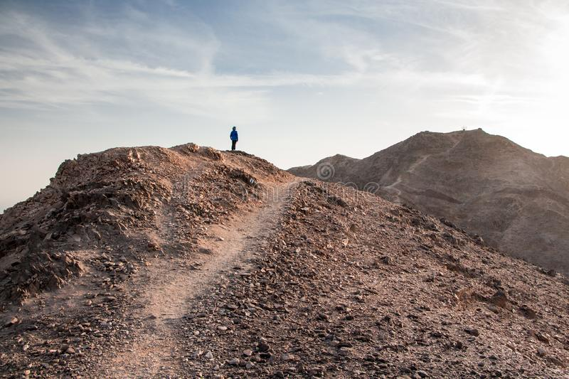 Mount Tzfahot, beautiful desert near Eilat. Hiker watching the sunset in the desert on the top of the mountain. red sea in the valley. Eilat mountains, Negev stock photos