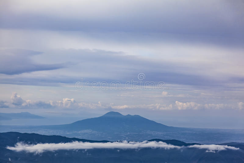 Mount Vesuvius. Aerial view of Mount Vesuvius with band of cloud in foreground royalty free stock photo