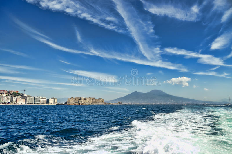 Mount Vesuvius and castle from a boat royalty free stock photography