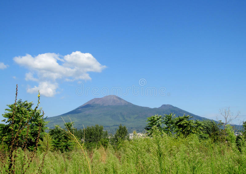 Mount Vesuvius in the distance in summer. View from Pompei ancient Roman ruins - Pompei Scavi stock photography
