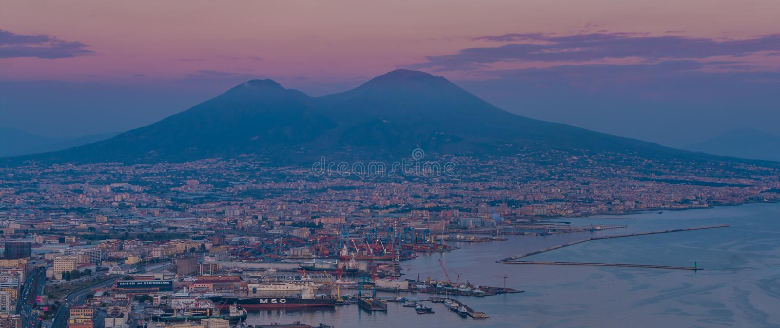 Mount Vesuvius II. A picture of Mount Vesuvius and the port area of Naples, at sunset royalty free stock image