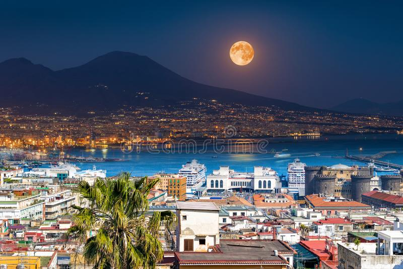 Mount Vesuvius, Naples and Bay of Naples, Italy. Opposites in nature: day and night, light and darkness. Elements of this image furnished by NASA stock images