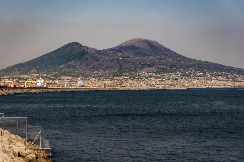 Mount Vesuvius. Naples, Italy. Mount Vesuvius view from the coast of the city stock photos