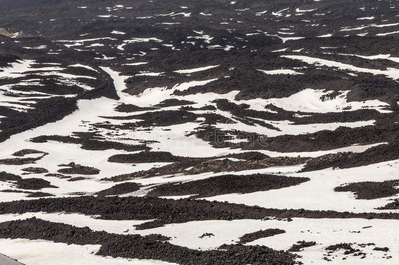 Mount volcano Etna, volcanic crater with striped snow. Sicily, Italy. royalty free stock images