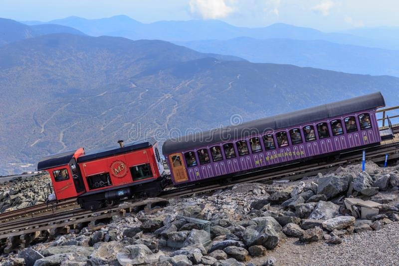 Mt. Washington Cog Railway, New Hampshire, USA. The Mount Washington Cog Railway is the world`s first mountain-climbing cog railway rack-and-pinion railway. The stock photography