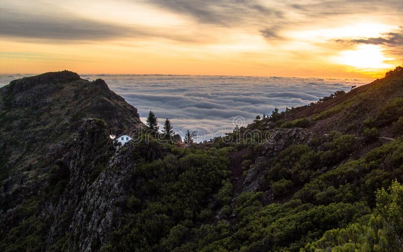 Mountain Above White Clouds during Sunset royalty free stock photography