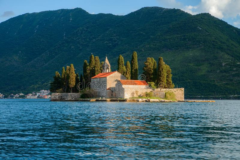 Mountain architectural landscape, view from the sea to the village of Perast, Montenegro. Mountain architectural landscape, view from the sea to the village of royalty free stock photos
