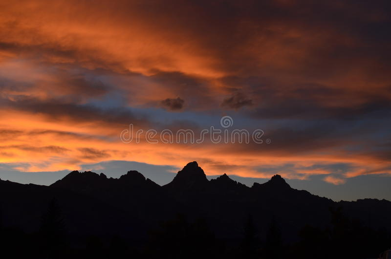 Download Mountain Area Under Cloudy Sky During Sunset Stock Photo - Image of sunrise, silhouette: 83014484