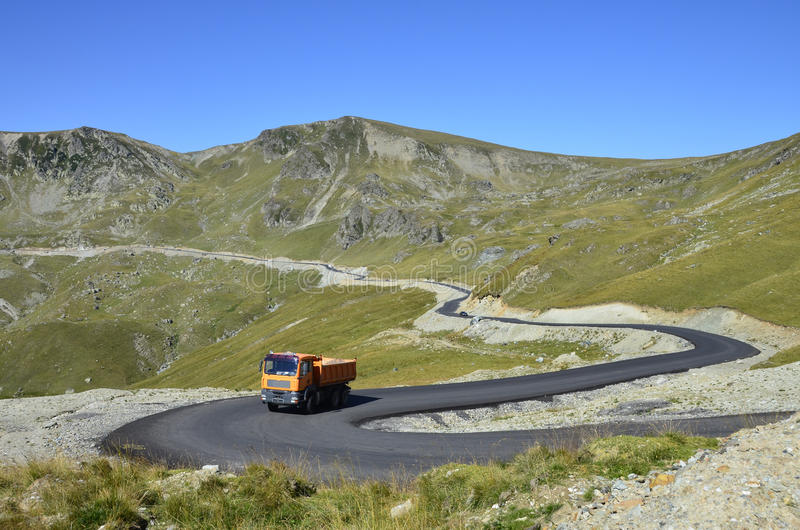 Mountain asphalt. Curved road recently constructed to Padina, Bolboci, Pestera chalets in Bucegi mountains near Bucharest, Sinaia, Ploiesti and Brasov city in stock photo