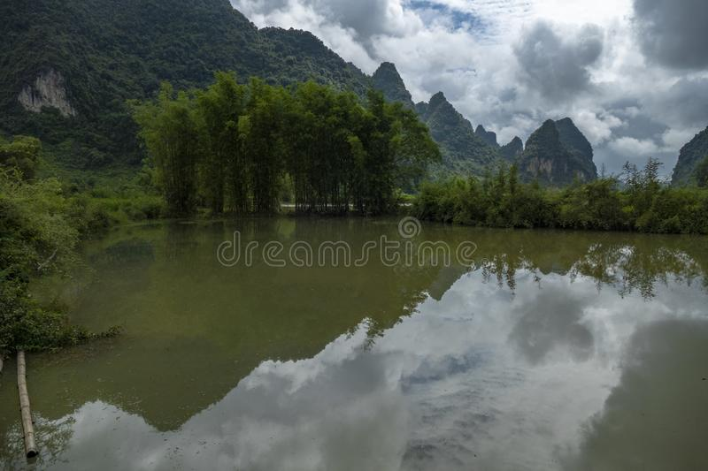 Mountain and bamboo, in Cao Bang, Vietnam. Mountain and bamboo and Qua Son River, in Cao Bang, Vietnam stock photography