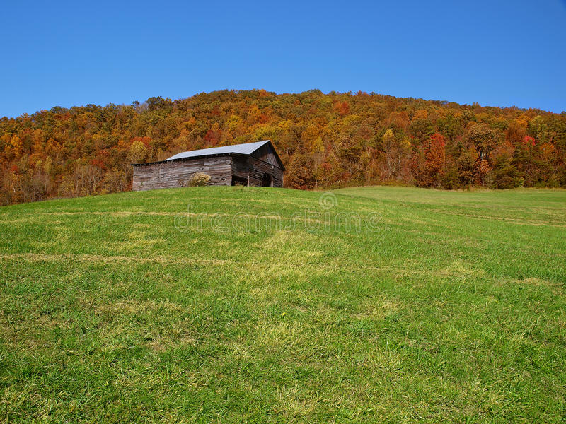 Mountain barn in autumn stock images