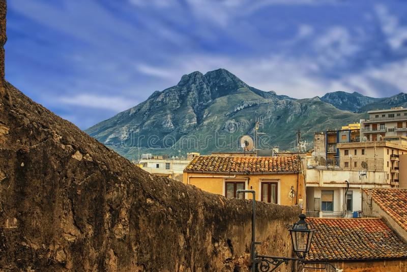 The mountain behind the city wall. The view from a historic part of the city over the old roofs on the San Calogero royalty free stock image
