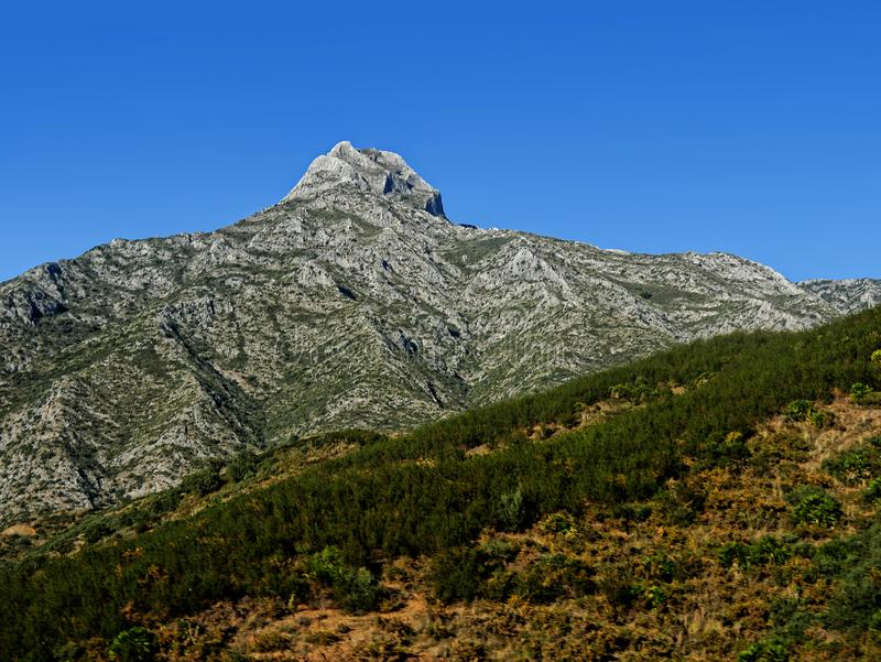 Mountain behind Fuengirola on the Costa del Sol Spain. Fuengirola on the Costa Del Sol Spain is a resort with a long beach, shops and all the facilities for stock images