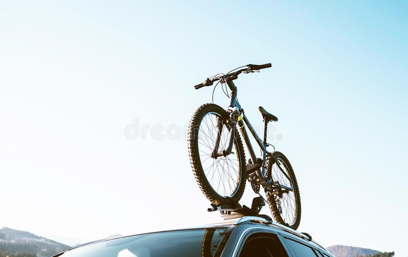 Mountain Bicycle fixed with Roof Mounted Bike Carriers instaled. On white Auto roof travel concept image royalty free stock photos