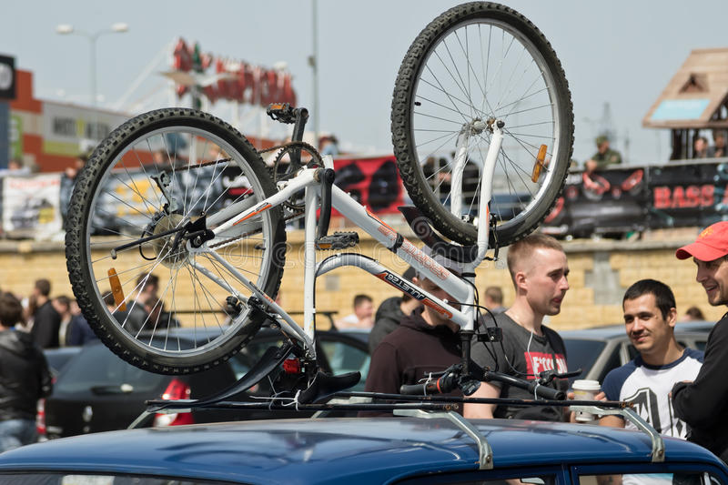 Mountain bike attached to the roof rack of the car of one of par royalty free stock images