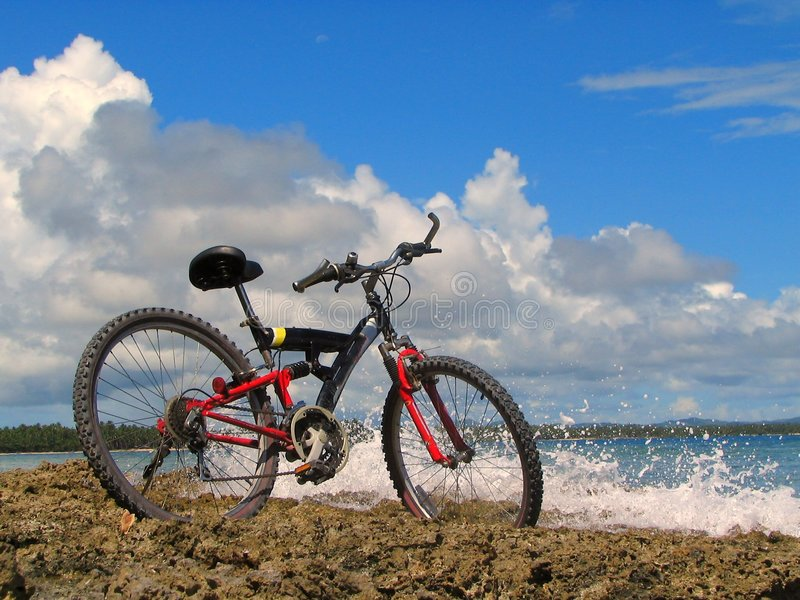 Mountain-bike on beach royalty free stock photo