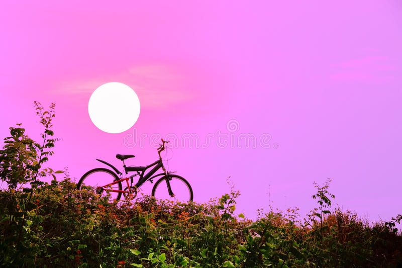 Mountain bike with a colorful sky and sunset. Closeup of the mountain bike with a colorful sky and sunset, vintage tone filter for poster or postcard stock photos