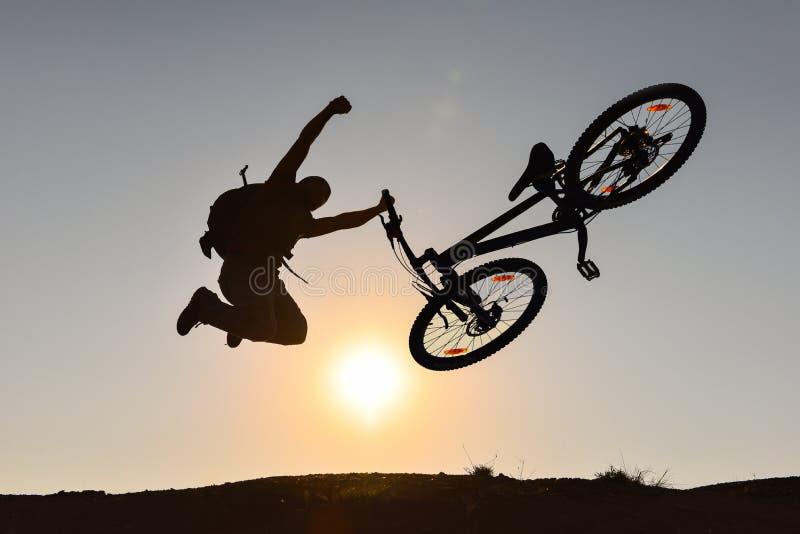 Mountain bike and crazy rider stock photo
