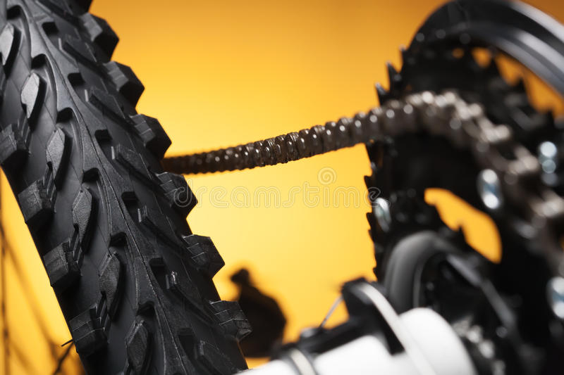 Part of the mountain bike, front sprocket and tire. Mountain bike, front sprocket and tire royalty free stock photos