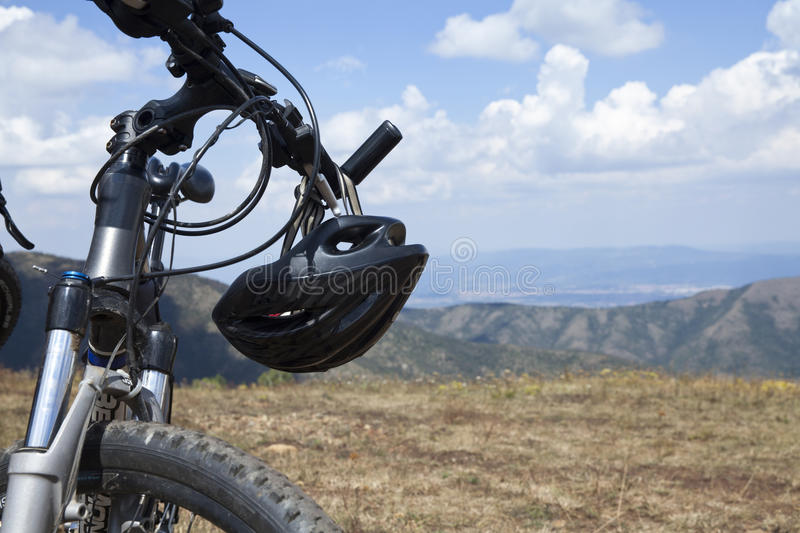 Mountain bike. With helmet, landscape close up stock images