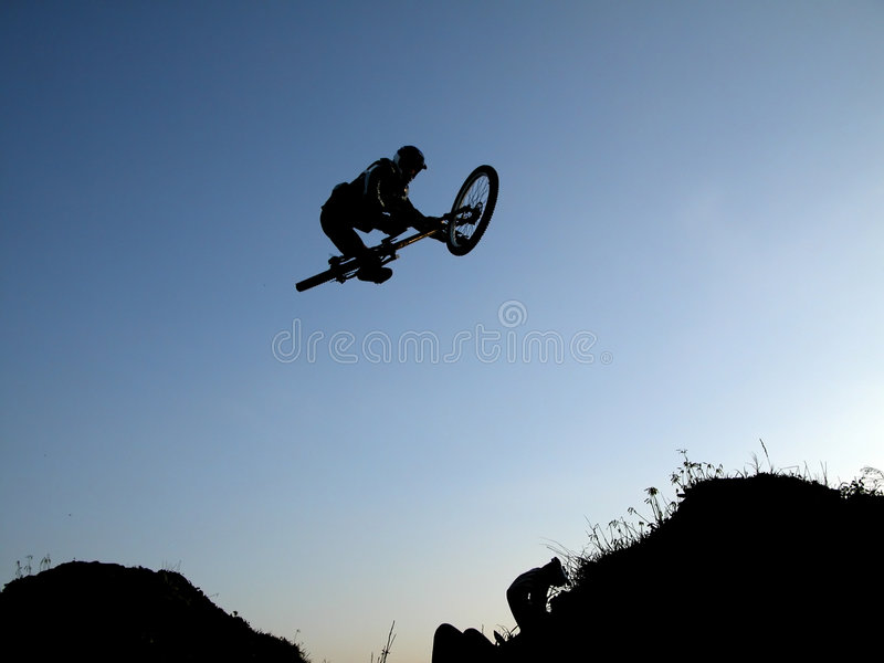 Mountain bike jump royalty free stock photography