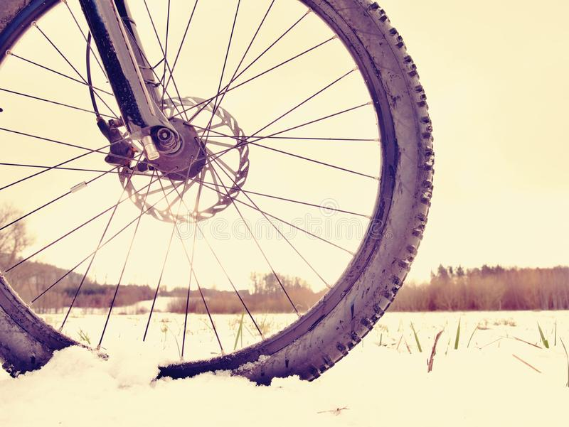 Mountain bike in powder snow. Lost path in snowdrift. Wheel detail. Mountain bike stay in powder snow. Lost path in snowdrift. Wheel detail. Snow flakes melting stock photos