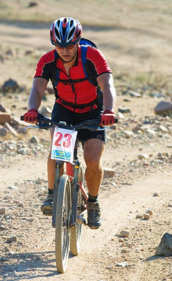 Mountain bike racer in desert stock photography