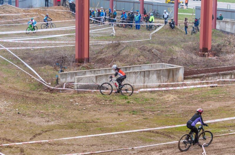 Mountain bike racers on mud stock image