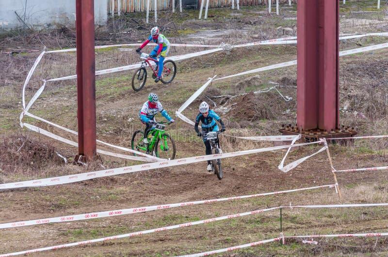 Mountain bike racers on mud royalty free stock image