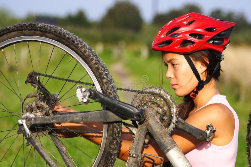 Mountain bike repair. Bike repair. Woman repairing mountain bike royalty free stock image