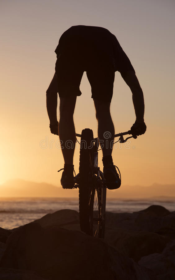 Mountain bike rider and sunset South Africa stock photo