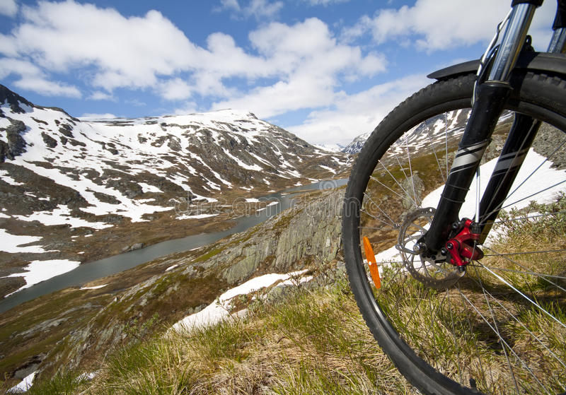 Mountain bike rider view. On Norway landscape stock photos