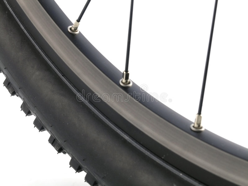 Mountain bike tire. Serie sport: Mountain bike tire isolated on white background (close-up royalty free stock images