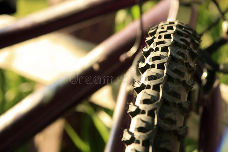 Mountain bike tire. Close-up of the treads on an old Mountain bike royalty free stock photography